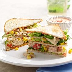 These piled-high tuna club sandwiches get a flavor punch from a blended sauce of creamy ranch salad dressing and roasted red sweet peppers -- and they take just 25 minutes to make.