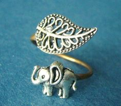 Silver elephant ring with a leaf wrap ring on Etsy, $19.00