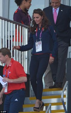 Kate wore a more casual outfit at today's event, she paired her Team GB fleece with blue skinny jeans and her new favourite wedges. August 3, 2012