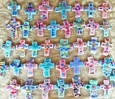 Salt dough crosses. Cookie cut out from 1/2 inch dough colored with acrylics paints. Put in paper clip for hanger and used pony beads for decor. Bake at 250 for 3 hours. No longer or will brown. Seal with modge podge.