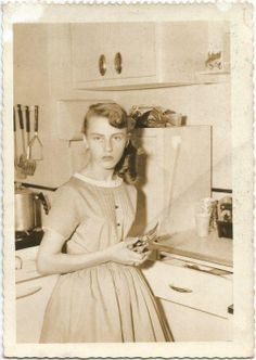 Kitchen snapshot of a girl in the 1950s