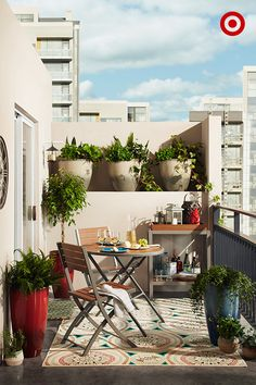 Create an urban oasis, balcony style. A bistro-sized table is perfect for a smaller space (this one even collapses for easy storage). Warm it up with an outdoor rug, and surround the area with colorful planters of varying heights. Fill the planters with a mix of flowers, herbs and veggies for added interest. And don't forget a fully stocked outdoor bar cart so you're always ready for entertaining.