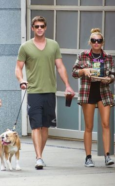Liam Hemsworth & Miley Cyrus from Celebrity Pets: Miley Cyrus' Puppy, Taylor Swift's Cat & More The engaged couple took their furry friend Ziggy out for a coffee run in Philadelphia. Liam Hemsworth And Miley, Miley And Liam, Latest Celebrity News, Celebrity Gossip, Old Miley Cyrus, Taylor Swift Cat, Divas, Famous Couples, Famous Celebrity Couples
