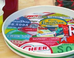 This DIY lazy susan is so cool - it was created from a planter saucer! Head to the hardware store and collect some vintage images for this fun craft.  Would make a great tray in a craft room too!