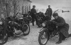 Russian troops examine German motorcycles abandoned by the retreating Germans on the Moscow Front, 1941. Unlike the Germans, the Russians are fully kitted out for the Russian winter with fur caps, padded tunics, woolen overcoast, and snow boots.