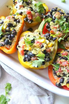 These Quinoa Stuffed Peppers with Vegan Jalapeno Cream Sauce are healthy and satisfying. Perfect meal prep lunch or dinner! | ThisSavoryVegan.com