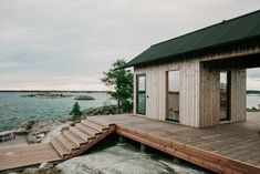 Large outdoor entertaining spaces allow the designers to enjoy the long summer days—and a hot tub and a traditional Finnish sauna make the chilly evenings cozy and fun. Ideas De Cabina, Summer Cabins, Finnish Sauna, A Frame Cabin, Cabin In The Woods, Wooden Cabins, Parc National, Scandinavian Home, Scandinavian Architecture