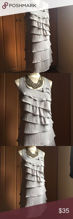 Gray ruffle dress by INC Gray ruffle dress by INC. 100%silk. Size 6. Preowned in excellent condition. This dress will hug your hips and make you feel like a flapper! INC International Concepts Dresses