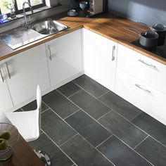 modern gray kitchen floor tile idea and wooden countertop plus white painted cabinets design feat contemporary sink with drain board
