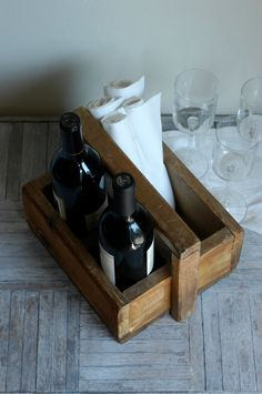 Vintage wooden tote. This is agreat idea for toting wine or something else to the backyard when entertaining. I'm getting one!