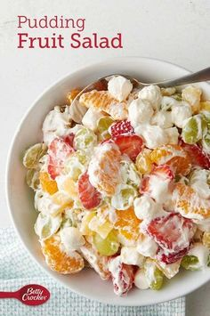 Betty's own unique take on the classic ambrosia fruit salad cleverly combines refrigerated vanilla pudding, miniature marshmallows and frozen whipped topping with fresh and canned fruit! Expert tip: This summer-fresh salad is a good counterpoint to a Fruit Salad With Pudding, Fruit Salad Recipes, Fruit Snacks, Jello Salads, Easy Fruit Salad, Marshmallow Fruit Salads, Yogurt Fruit Salad, Summer Fruit Salads, Recipes With Canned Fruit