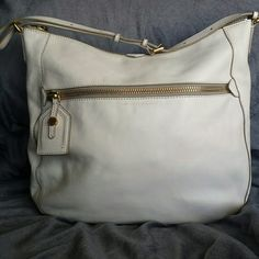 MARC by MARC JACOBS Large White Leather Bag REASONABLE OFFERS ENCOURAGED!  Marc by Marc Jacobs Large white leather bag. Gold tone hardware. Gently used condition. Has outside zipper and cute luggage tab type zipper pull. Only wear I noticed was on the bottom of the strap where the bag would sit on your shoulder and the inside lining is dirty. Hardware has scratches. Have not tried to clean. This is a good size bag.  Measurements taken lying flat Width 17.5 inches Strap drop 7 inches  Height…