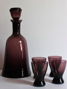 Mid Century amethyst decanter and glasses by FussbudgetVintage