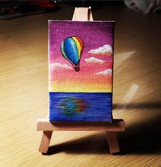 Tiny painting of a Hot Air Balloon. Acrylic on mini canvas 8 x 5 cm. By Caterina Bassano