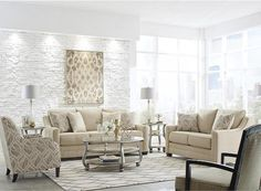 This beautiful sofa will add inviting style to any living space. Its modern design features a plush, supportive back, track arms with scalloped curves and high-
