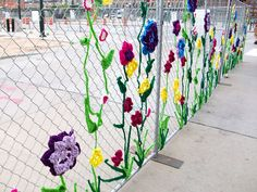 Isn't this just wonderful? I hate chain link fences but this one I could live with... I do believe someone has yarn bombed this fence!