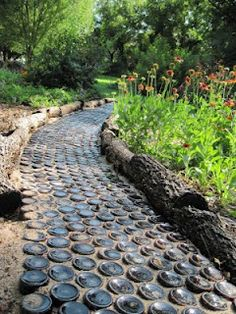 beautiful path made from beer bottles! sadly not going to work in an Iowa climate : (