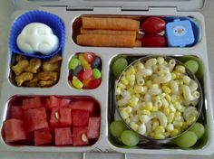 school lunch in  a planetbox - car shaped hard boiled egg, pretzel Goldfish, watermelon, carrots, cherry tomatoes, ranch dip, pasta and sweetcorn in ranch dressing, a few grapes, and jellybeans.