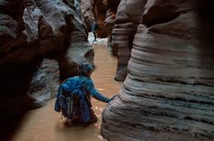 Pools in Buckskin Gulch can be anywhere from ankle to neck deep, and they are always cold.- 20 Hikes That Will Make You Feel Like a Badass