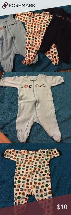 Baby boy sleeper bundle. Newborn. Sports Newborn sleepers in size newborn. Great condition. Zipper. Washed but never worn. Gerber One Pieces Footies