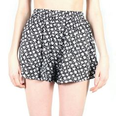 Minkpink mini shorts Minkpink  super cute shorts great for spring and summer. Very flare, looks like mini skirt. Can be worn high waisted with tank top. Pockets on the sides. 100% viscose. Elastic waistband. Worn only once. Bought on revolve clothing. MINKPINK Shorts
