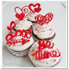Valentine Cupcake Toppers  Could make it with white chocolate and food coloring