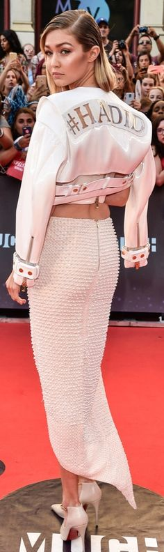 Gigi Hadid wore a pearl-embellished crop top and slitted midi skirt to the MuchMusic Video Awards, topping off her look with a #Hadid-emblazoned cropped moto jacket.