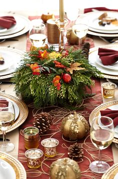 Thanksgiving Table and Centerpiece - The centerpiece is really the pièce de résistance of the table, and can tie together a complete fall look.