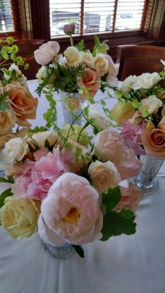 Peach, blush color flowers.   In bloom, ltd.