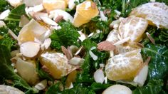 Simply dressed kale with olive oil and flaky sea salt, topped with orange segments and almonds