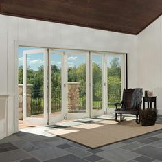 Bi-Fold Door.  The ideal solution for indoor/outdoor luxury living—our smart, stylish Bi-fold Door opens wide to infuse a space with fresh air and spectacular views. Here the door is shown in the process of being opened. It folds on itself to create a wide, unobstructed opening.