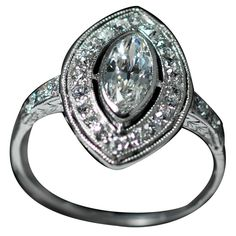 1920s Art Deco Marquise Cut Diamond Platinum Cluster Ring | From a unique collection of vintage cluster rings at https://www.1stdibs.com/jewelry/rings/cluster-rings/