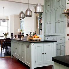 Modern Victorian kitchen - pale blue cabinets and black granite worktops. Blue Kitchen Cabinets, Painting Kitchen Cabinets, Kitchen Paint, Home Decor Kitchen, New Kitchen, Home Kitchens, Kitchen Ideas, Tall Cabinets, Green Kitchen
