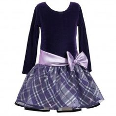 A cute and stylish dress for your girl from Bonnie Jean. Black velour top onto a multi-layer sparkling tartan plaid skirt. Grey tulle overlay has allover shiny spots. It features purple shimmering satin waistband with bow. For added flare and fullness the