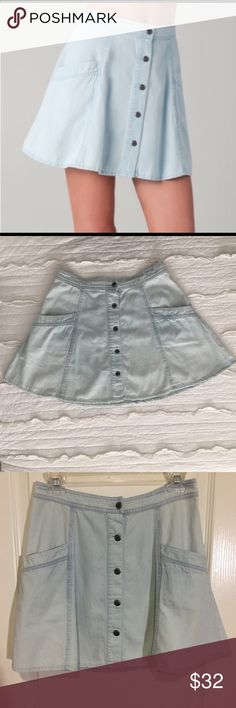 """Free People Chambray Button Down Circle Skirt NWOT  Look cute as a button in this Free People circle skirt. Has two front pockets and sits at the waist.  All measurements taken with garment lying flat.  -size 6 -waist 13 1/4"""" -length 15 1/2"""" Free People Skirts Circle & Skater"""
