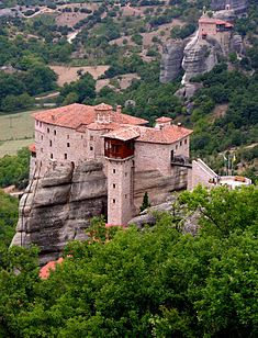 """Agia Triada Monastery, Meteora Greece - (The Monastery of Holy Trinity) - built in 1475 but occupied by monks as early as the 9th century (1029-1048). Metéora (Greek: Μετέωρα, """"suspended rocks"""", """"suspended in the air"""" or """"in the heavens above""""). built on natural sandstone rock pillars, at the northwestern edge of the Plain of Thessaly. nearest town is Kalambaka. the Meteora is on the UNESCO World Heritage List. it'sthe second largest & most important site Eastern Orthodox monasteries in…"""