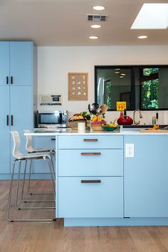 Love the pastel blue kitchen cabinets.