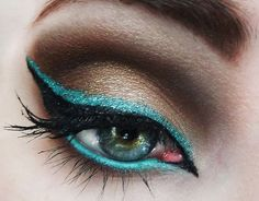 Gold, teal and black eye makeup