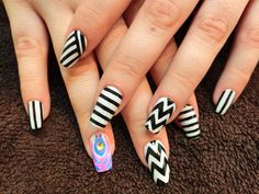 The cartoon caricature on the ring finger of the right hand stands out among the other fingers due to its ingenuity. The black and white stripes lend an air of authenticity.