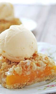 Peaches and Cream Bars a la Mode – summer dessert at it's best! Quick and easy crumb bars with peach pie filling, drizzle of cream glaze and a scoop of vanilla ice cream – let's dig in!