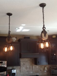 Kitchen Lighting Remodel These West Ninth Vintage pulley lights complete this dark cabinet kitchen. Vintage Industrial Lighting, Rustic Lighting, Lighting Ideas, Rustic Industrial, Industrial Lamps, Farmhouse Lighting, Kitchen Lighting, Pulley Light, Vintage Light Fixtures