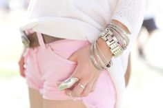 pink shorts, leather belt, arm full of chunky silver & one cool finger ring....