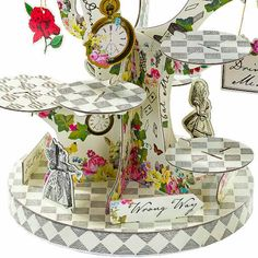 With this Truly Alice tree shaped cake stand, you can create your very own whimsical party setting that will put the finishing touches to your party table.  READY TO SHIP Perfect for weddings, afternoon tea parties and other special occasions, this impressive cake stand holds plenty of yummy cupcakes, pastries, canapés or any party food that needs showing off!  A perfect centrepiece for any celebration, decorate the table with our Truly Alice range napkins, tea pot vase and paper plates to…
