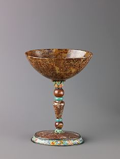 Moss agate and enamel stem cup ca 1000 BC