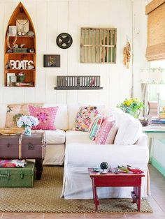 Nice color accents with the pillow, little end table and suitcases.  Not aqua, I know, but nice examples.
