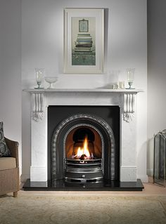 "Kingston Package    Mantle: Kingston 56"" Carrara Marble  Insert: Henley Highlight  Fire: Decorative Gas Fire with Ceramic Coals  Hearth: Granite    £1,299.00"