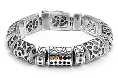 Silver bracelet, slink, with wild cat motif. Set with mix colors of semi precious stones