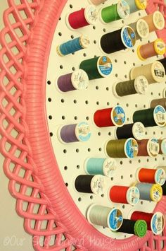 thread holder from a thrift store mirror, home decor, home office, repurposing upcycling, wall decor