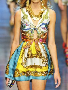 gotta love vintage Versace!! I would love to rock this, but close up that keyhole and loose the gypsy accessories