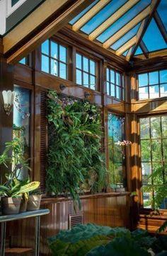 a green living wall to hide the air conditioning units